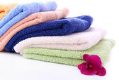 Orchid flower and towels, isolated on white — Stock fotografie
