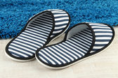 Striped slippers on floor background — Stock Photo