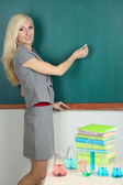 Chemistry teacher writes in chalk on blackboard close-up — Stock Photo