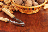 Nutcracker with nuts on wooden table close-up — Stock Photo