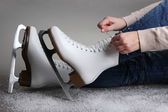 Skater wearing skates on gray background — Stock Photo