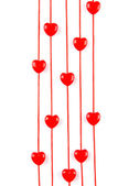 Heart-shaped beads on string isolated on white — Stock Photo