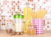 Products for cooking in kitchen on table on mosaic tiles background — Stock Photo