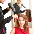 Young mhairdresser do hairstyle girl in beauty salon — Stock Photo #38219741