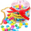 Stock Photo: Paper stars with dreams in jar isolated on white