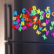 Stock Photo: Colorful magnetic letters on refrigerator