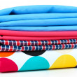 Stock Photo: Pile of colored fabrics isolated on white
