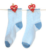Socks hanging on clothesline isolated on white — Stock Photo