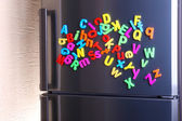 Colorful magnetic letters on refrigerator — Photo