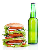 Huge burger and bottle of cold drink, isolated on white — Stock Photo