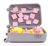 Open suitcase with paper stickers isolated on white — Stock Photo