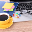 Laptop with stationery and cup of coffee on table — Stock Photo #38324165