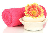 Rolled pink towel, soap bar and beautiful flower isolated on white — Stock Photo