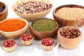 Different kinds of beans in bowls isolated on white — Stock Photo
