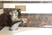 Ceramic sink with chrome fixture, close up — Stock Photo