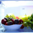Stock Photo: Fresh fruits on shelves in refrigerator