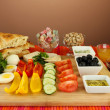 Traditional Turkish breakfast on table on brown background — Stock Photo #38359363