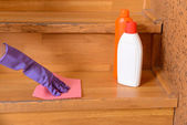 Female hand in rubber glove cleaning staircase — Stock Photo