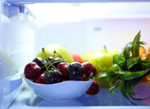 Fresh fruits on shelves in refrigerator — Photo