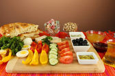 Traditional Turkish breakfast on table on brown background — Stock Photo