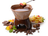 Chocolate fondue with fruits, isolated on white — Stock Photo
