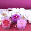 Composition with beautiful colorful candles, sea salt and orchid flowers, on color background — Stock Photo #38360569
