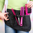 Womhairdresser with tool belt on bright background — Stock Photo #38360971