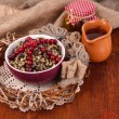 Stock Photo: Bowl with kutia - traditional Christmas sweet meal in Ukraine, Belarus and Poland, on wooden background