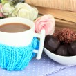 Stock Photo: Cup with knitted thing on it close up