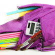 Purple backpack with school supplies isolated on white — Stock Photo #38367939