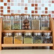 Set of spices in kitchen on table on mosaic tiles background — Stock Photo
