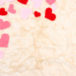 Beautiful decorative hearts on old paper background — Stock Photo #38369037