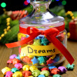 Stock Photo: Paper stars with dreams on table on dark background