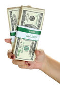 Packs of dollars in hand isolated on white — Stock Photo