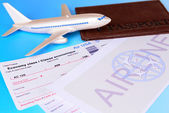 Airline tickets with passport on light blue background — Stock Photo