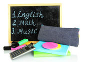 Pencil box with school equipment and timetable isolated on white — Stockfoto