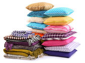 Hills colorful pillows and plaids isolated on white — Stock Photo