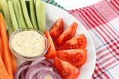 Assorted raw vegetables sticks in plate on napkin close up — Stock Photo