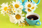 Beautiful bouquet chamomiles in pitcher on wooden table close-up — Stock Photo