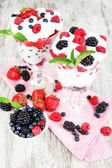 Natural yogurt with fresh berries on wooden background — Stock Photo