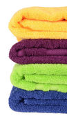 Bright towels isolated on white — Stock Photo