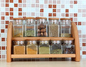 Set of spices in kitchen on table on mosaic tiles background — Foto de Stock