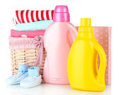 Softener dryers and washing powder with children clothes isolated on white — Stock Photo