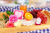 Breakfast in bed on Valentine's Day on room background — Stock Photo