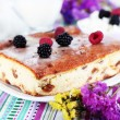 Cheese casserole with raisins on plate on napkin on wooden table close-up — Stock Photo #38460159