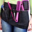 Womhairdresser with tool belt on bright background — Stock Photo #38462903