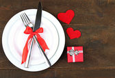 Romantic holiday table setting, on wooden background — Zdjęcie stockowe