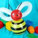 Simple balloon animal bee, on bright background — Stock Photo