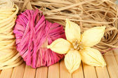 Decorative straw for hand made, flower and heart of straw, on wooden background — Stock Photo