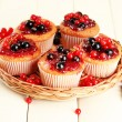 Tasty muffins with berries on white wooden table — Stock Photo #38595207